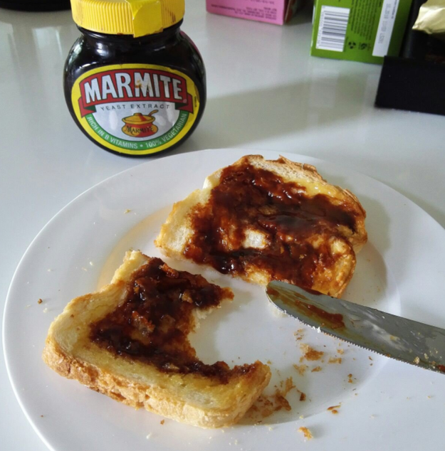 Spreading Marmite over buttered toast.