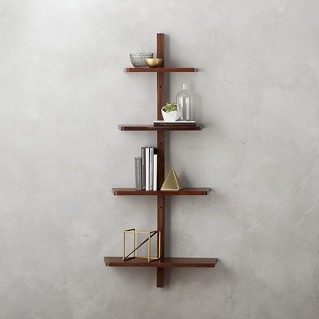 A tree-like wall shelf that really tests your reaching abilities.