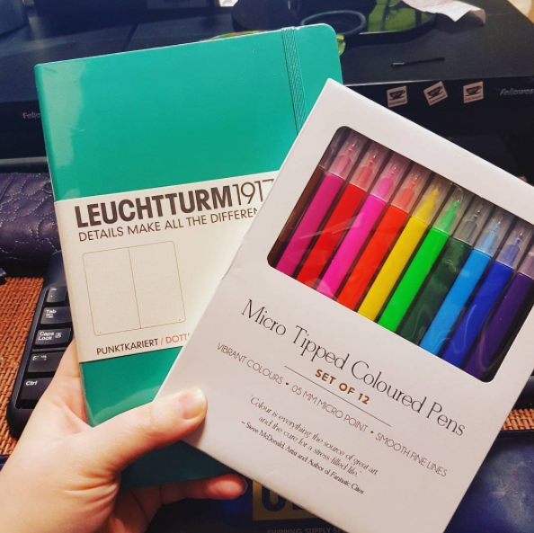 Begin by getting a new notebook and something to write with.