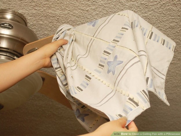 Use an old pillowcase to clean ceiling-fan blades.