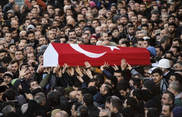 People on Jan. 2 carry the coffin of Yunus Gormek, 23, one of the victims of the Reina nightclub attack.