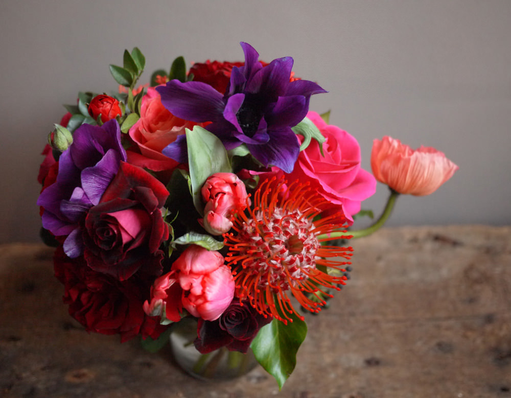 A colorful arrangement of purple, pink, and red flowers