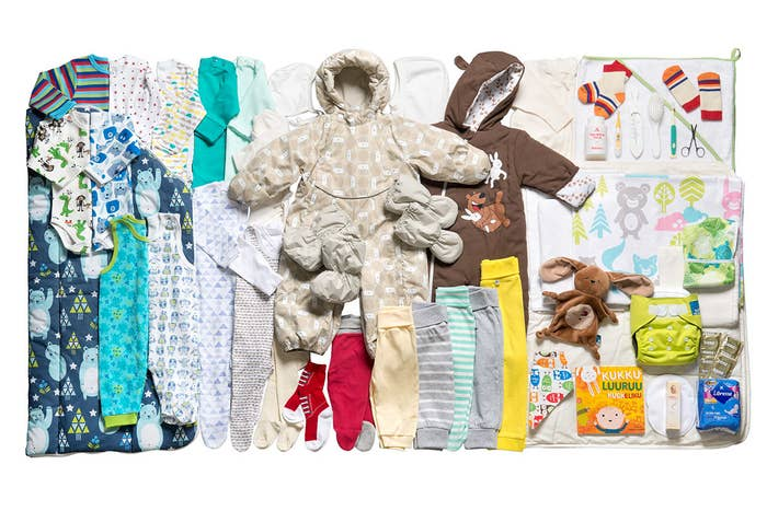 """The Finnish boxes are filled with gender-neutral clothes (including outdoor clothes), diapers, toys, and more, to guarantee that all new parents have the basic necessities. A small mattress, sheets, and blankets also come inside the box so that it can double as a safe place for the baby to sleep if necessary (similar to a bassinet). According to the BBC, """"It's a tradition that dates back to the 1930s and it's designed to give all children in Finland, no matter what background they're from, an equal start in life. ... Many children, from all social backgrounds, have their first naps within the safety of the box's four cardboard walls."""""""