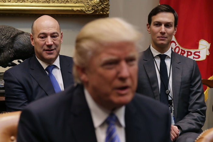 Former Goldman Sachs President Gary Cohn, left, is now a top economic official in the Trump administration.