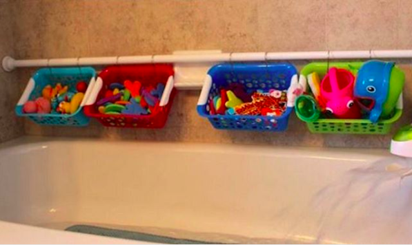 Use a shower rod and small plastic baskets to make the perfect way to store your kid's bath toys.