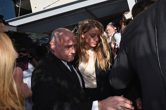 Amber Heard leaves Southport Magistrates Court with Johnny Depp in Australia.