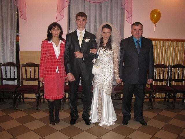 Yuri Karpenko with his wife, Kristina and her parents, George and Larisa Gablita, on their wedding day.