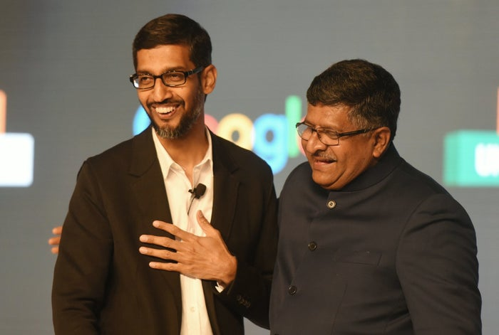 Google CEO Sundar Pichai shakes hands with Indian Union Minister for Law, Justice, and Electronics and Information Technology Ravi Shankar Prasad at an event in New Delhi.