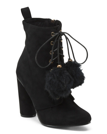 Heeled Catherine Malandrino booties with pom-pom laces.