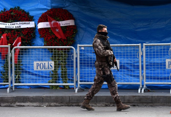 A Turkish police officer patrols outside the nightclub where a gunman killed 39 people on New Year's night.