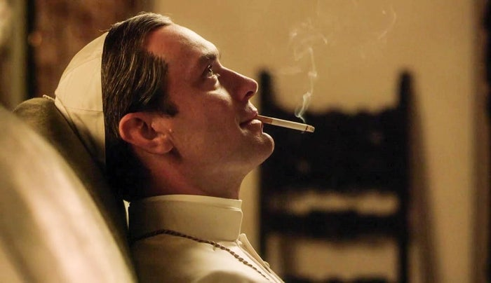 Law plays Lenny Belardo, aka Pius XIII, who is not only a Very Young Pope but also the First American Pope. He SMOKES and does NOT play by the rules.