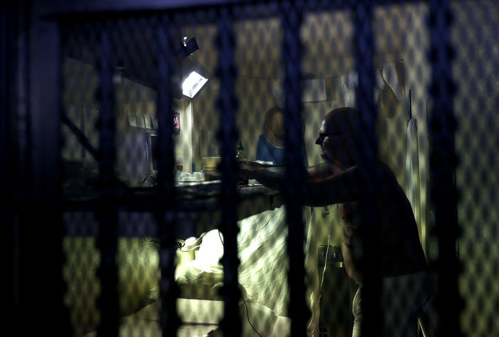 An inmate sits in his cell at San Quentin State Prison.