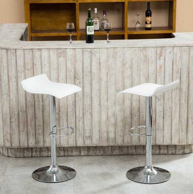 Adjustable swivel bar stools with just enough area for your butt.