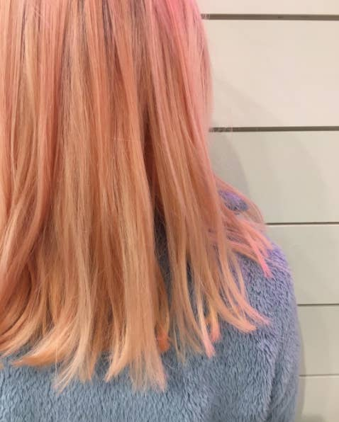 This trendy hair color consists of pastel shades of orange and red.