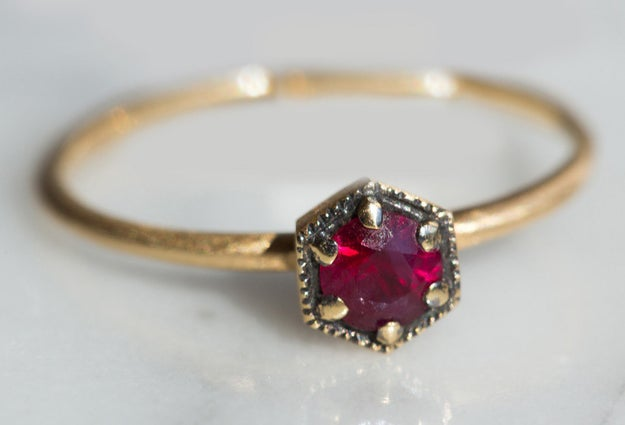 A delicate scarlet ruby ring that looks it belongs in a chest of family heirlooms.
