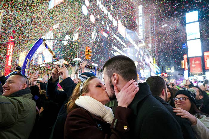 Kaitlin Olivi of Yonkers, New York, and Lucas Pereira, of Sayreville, New Jersey, kiss as confetti falls during a celebration of the New Year in New York's Times Square.