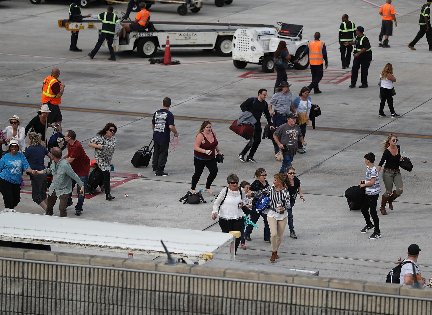 Crowds also spilled onto the tarmac as authorities worked to secure the scene.