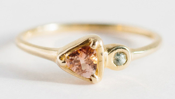 A sapphire and sunstone soleil ring that always points in the direction of true, everlasting love.