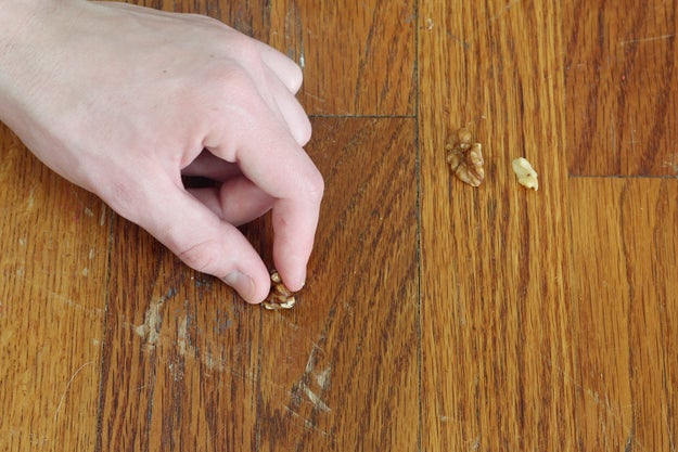 Eliminate scratches on wood... with a walnut.