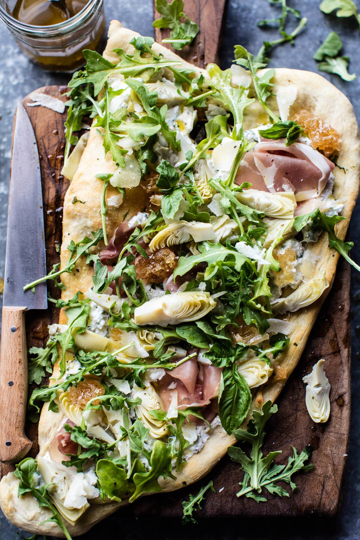 Looks fancy — but is actually super easy to assemble thanks to using naan as the base, and store-bought ingredients (arugula, prosciutto, ricotta, artichoke hearts) as the toppings. Recipe here.