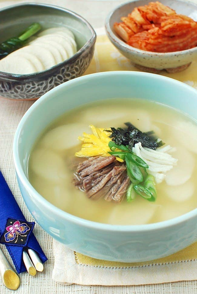 The tradition of consuming this soup, also known as Tteokguk, on New Year's day symbolizes turning another year older. It's also associated with purity, cleanliness, and longevity. Recipe here.