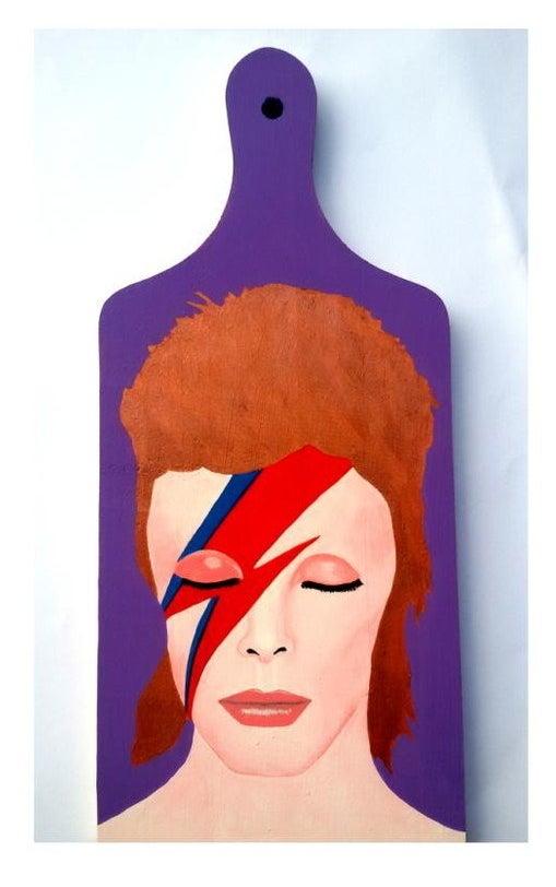 David Bowie JAMAIS veria uma tábua de carne com a cara dele em qualquer outro lugar do mundo.
