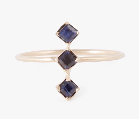 A stacked sapphire ring that looks like a row of miniature baseball diamonds.