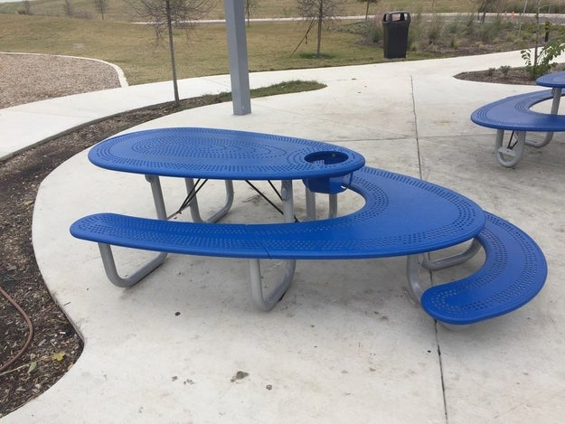 This picnic table that has seating for a high chair, kids, adults, and people using wheelchairs all at once.