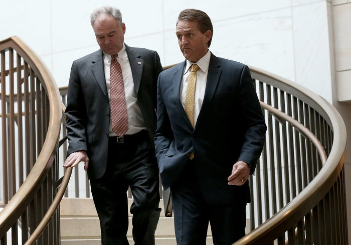 Sens. Tim Kaine and Jeff Flake on Capitol Hill in 2015.