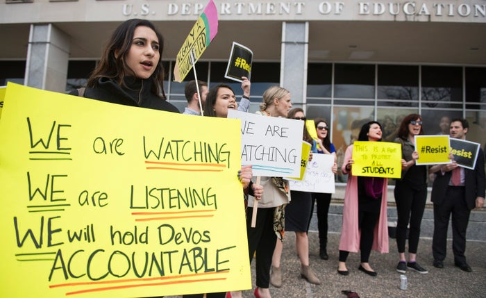 Protesters gathered outside the Department of Education as Education Secretary Betsy DeVos prepared to deliver remarks to staff on her first day as secretary in Washington, DC.