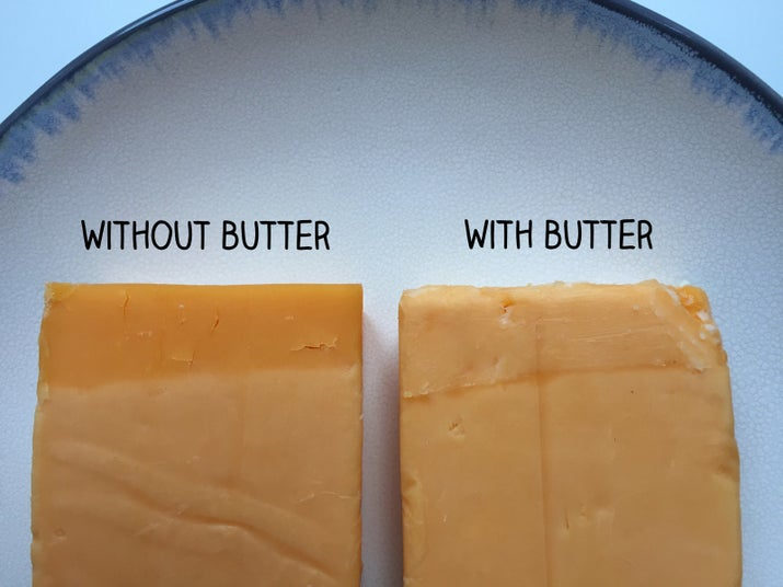 THE IDEA: Pretty much just rubbing the edge of cheese that's exposed to air with some butter. I wrapped two pieces of cheddar in plastic wrap, leaving just the edge open. I then rubbed butter on one and left the other one alone.