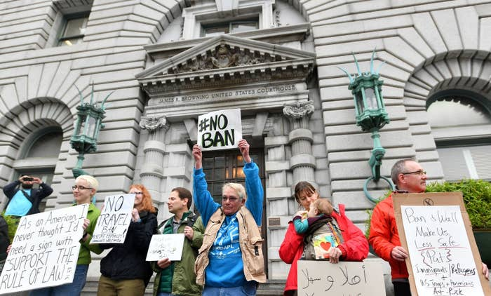 Protesters stand in front of the United States Court of Appeals for the Ninth Circuit.