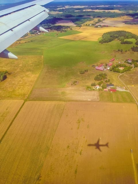 """This was when I was flying into Stockholm and I happened to catch the plane's shadow in a photo."""