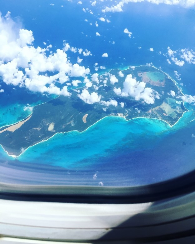 """Flying over the Caribbean Islands on my way to a family vacation to Puerto Rico! The colors in this photo are NOT edited at all, the water truly is this blue!"""