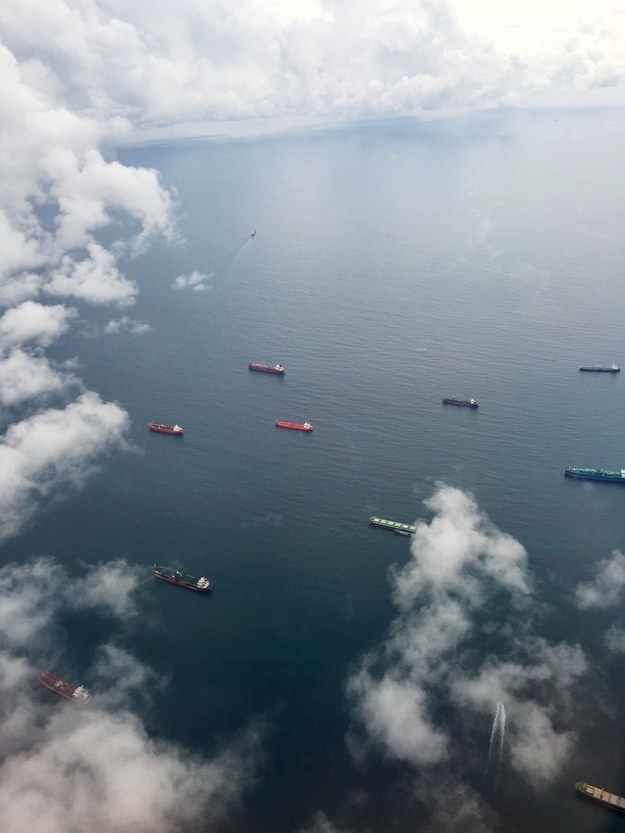"""Ships lining up to end the Panama Canal from the Pacific Ocean to the Atlantic."""