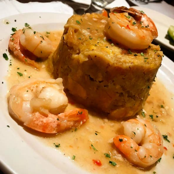 What is it: Deep-fried green plantains mashed together with sautéed onion, garlic, olive oil and other ingredients such pork or seafood.Taste: Heavenly & delicious.Conclusion: Why don't we eat more mofongo?Get a recipe here.