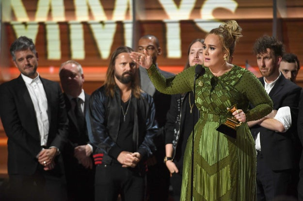 "In her emotional speech after winning Album of the Year — the Grammy Awards' top honor — Adele stunned the audience by saying she ""couldn't possibly accept this award"" and it should've gone to Beyoncé."