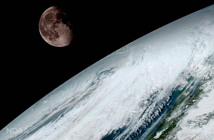 An image of Earth and the moon taken by the newest satellite in NOAA's GOES series.