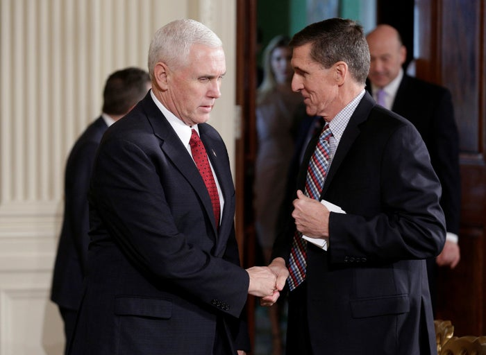 Mike Pence greets Michael Flynn at the White House on Feb. 10.