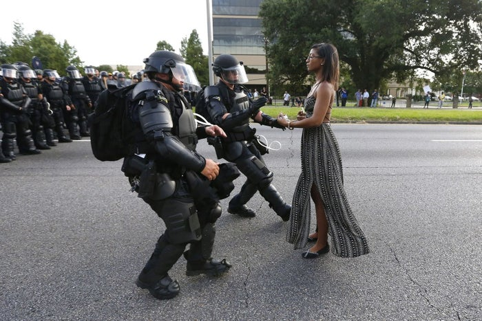 Ieshia Evans stands her ground while offering her hands for arrest as she is charged by riot police during a protest against police brutality outside the Baton Rouge Police Department in Louisiana.