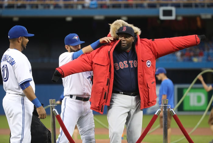 David Ortiz is presented with a parka from Canada Goose, as a present from the Toronto Blue Jays.