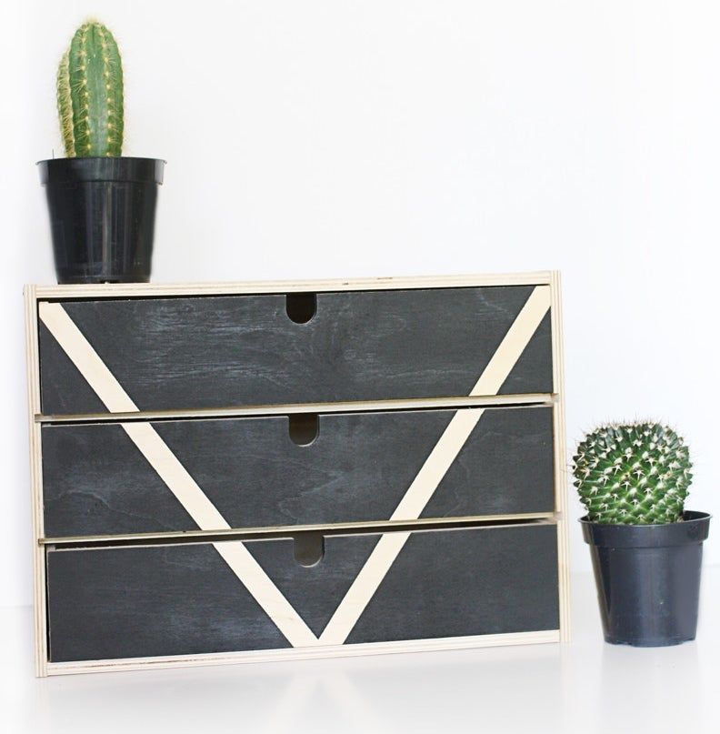 Tape and spray paint are the only tools you'll need to transform your organizer from drab to fab.