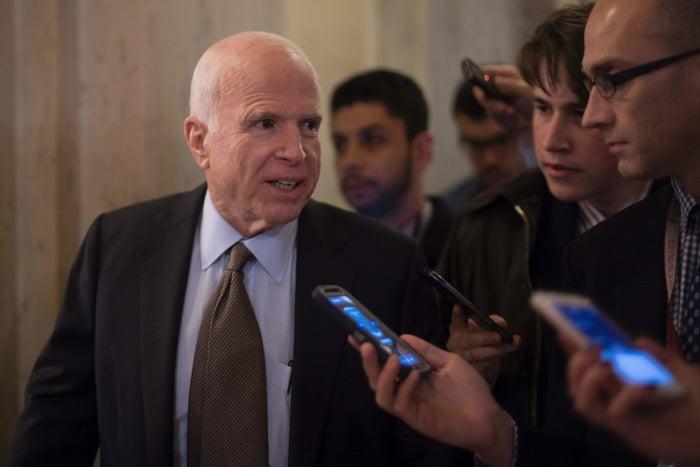 US Senator John McCain, R-Arizona, talks with reporters on Capitol Hill.