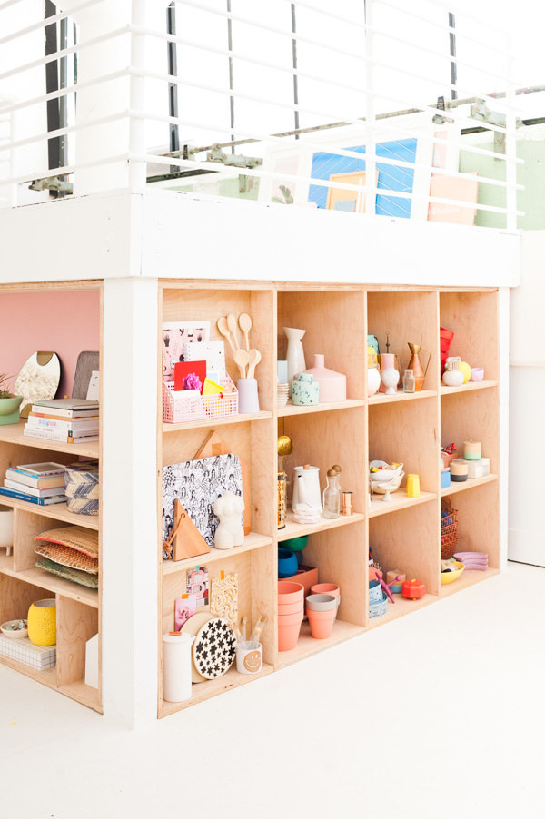 Line a recess with easy plywood shelving to organize your bigger, prettier supplies.
