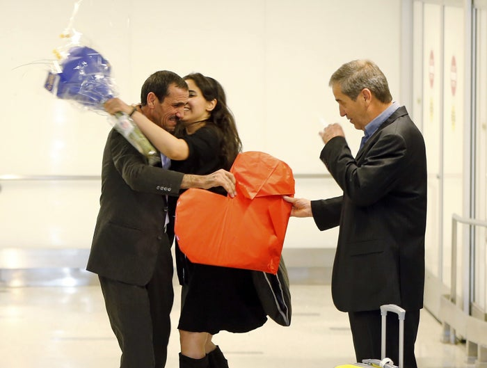 Ali Vayeghan, an Iranian citizen with a valid U.S. visa, left, is kissed by his niece Marjan Vayghan, at LAX on Feb. 2, 2017.