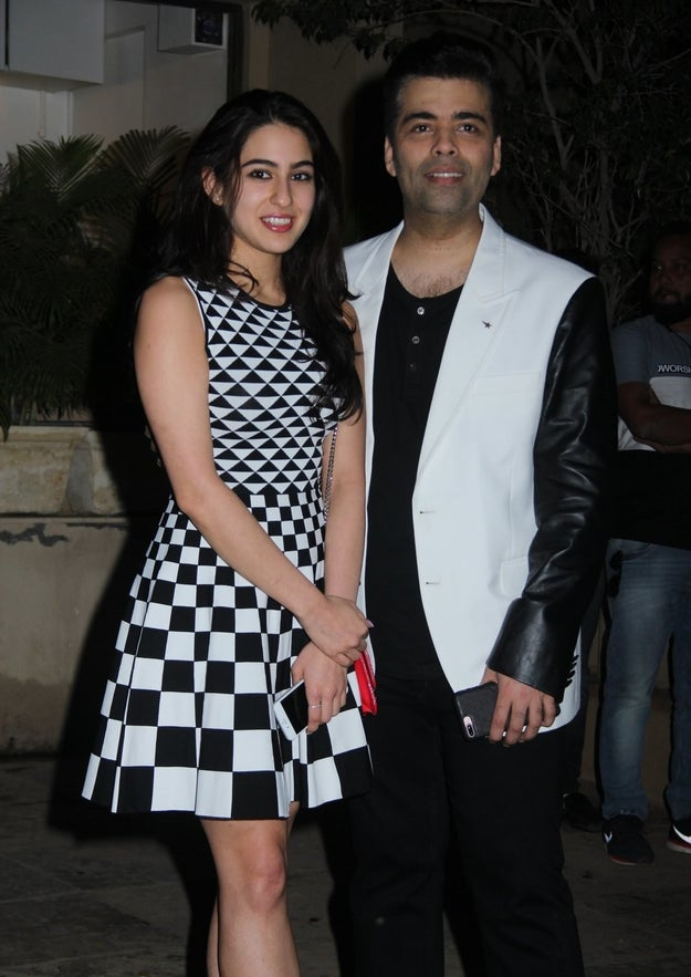And his date for the evening was Saif Ali Khan's daughter Sara Khan who will be launched in Karan's Hindi remake of Sairat. The two colour-coordinated for the birthday bash.