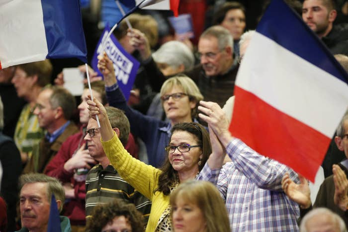Supporters attend a political rally for François Fillon, a right-wing candidate from the Les Républicains party, in Margny-les-Compiegne, France, Feb. 15, 2017.