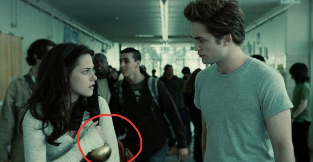 Bella is carrying the golden onion as she leaves the classroom because she and Edward won it in biology — mostly due to the fact that he is a bajillion years old and attending high school for the bajillionth time.
