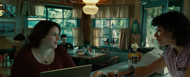 The author, Stephenie Meyer, made a lil' appearance in this scene in the cafe.