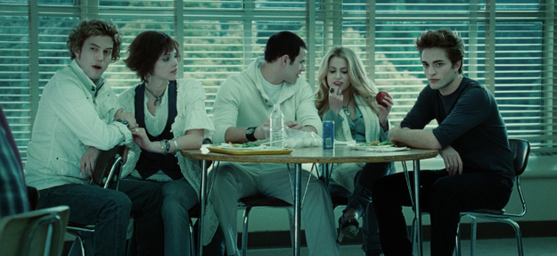 The Cullens are all matching except for Edward — the only one at the table not wearing white for some reason. (Uh, did you not get the memo, Eddy?)